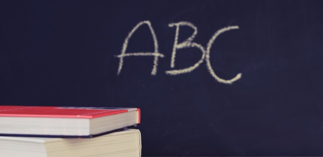 generic school photo of chalkboard with ABC and books