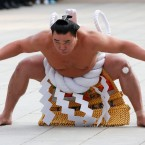 Sumo grand champion Harumafuji of Mongolia performs his ring entry forms at the Meiji Shrine in Tokyo, Friday, Jan. 6, 2017.
