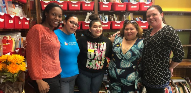 Roselyn Ventura won the Tenacity Award at her Chicago public school for changes she made in her behavior with help from Communities In Schools of Chicago. From left to right: Saucedo teacher Tara Burns; Communities In Schools student services manager Juanita Herrera; Roselyn Ventura; Roselyn's mother Rosa Ventura; Saucedo Principal Virginia Hiltz.