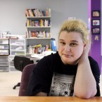 In this May 19, 2016 photo, Paige Petri, a student, poses at Horizon High School, a school that allows teens to get counseling and drug testing while they study alongside other recovering addicts, in Madison, Wis. Petri said she started smoking pot and getting high on cough medicine two years ago. Now a student at Horizon, she said she expects to graduate in a couple of years and that it likely wouldn't have been possible if not for the Madison school.