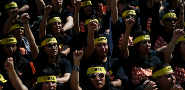 "People protesting against human trafficking and slavery raise their fists during a demonstration in Mexico City, Saturday, Oct. 14, 2017. Dozens of people participated in Mexico City's silent ""Walk for Freedom,"" one of multiple coordinated events in countries around the globe."