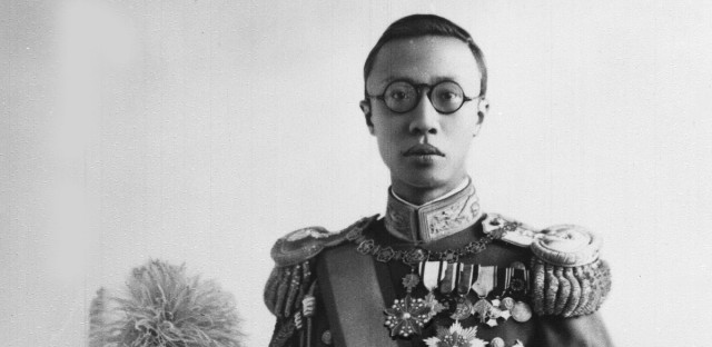 Henry Pu-Yi, former child emperor of China, is shown wearing the uniform of Admiral of the Fleet of the Manchukuan Navy, in 1936, at unknown location in china.