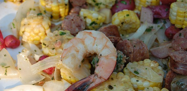 Lowcountry boil with sweet corn, potato, andouille sausage, shrimp, and hot sauces by Carriage House chefs Mark Steuer and Sean Spradlin with Nichols Farm & Orchard, Green Acres, and Gunthorp Farms