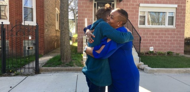 #FoldedMap participants Carmen Arnold-Stratton (right) of the 5600 block of S. Winchester in Englewood, and Brighid O'Shaughnessy (left) of the 6500 block of N. Winchester in Rogers Park embrace after their first visit.