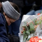 One of victim Vicente Juarez's daughter Diana Juarez cries at a makeshift memorial Sunday, Feb. 17, 2019, in Aurora, Ill., near Henry Pratt Co. manufacturing company where several were killed on Friday.ere several were killed on Friday.