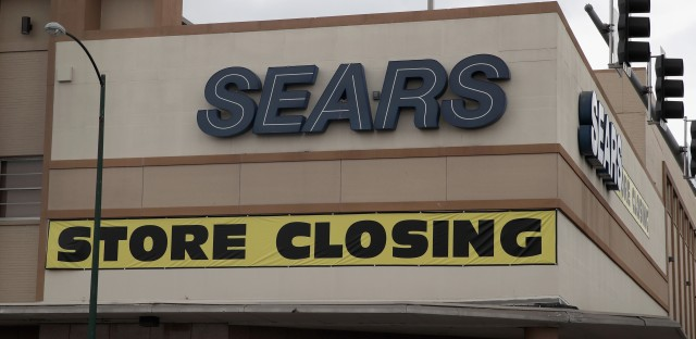 CHICAGO, IL - AUGUST 24: A sign announcing the store will be closing hangs above a Sears store on August 24, 2017 in Chicago, Illinois. Sears Holdings Corporation, which owns both Sears and Kmart, said today it was planning on closing another 28 Kmart stores. (Photo by Scott Olson/Getty Images)
