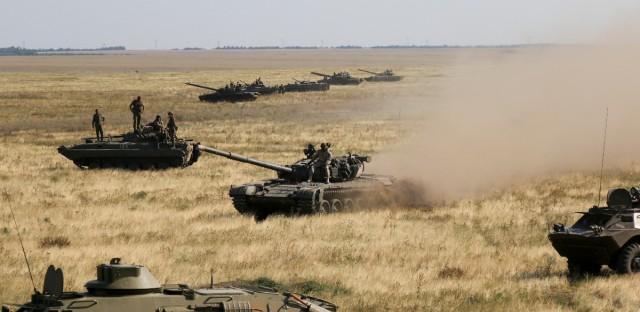Ukrainian tanks and APCs move towards the de-facto border with Crimea near Kherson, southern Ukraine on Aug. 12, 2016. Ukraine put its troops on combat alert Thursday along the country's de-facto borders with Crimea and separatist rebels in the east amid an escalating war of words with Russia over Crimea.