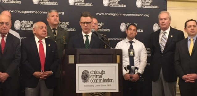 "Andrew Henning, vice president of the Chicago Crime Commission, presents the newest version of ""The Gang Book."""