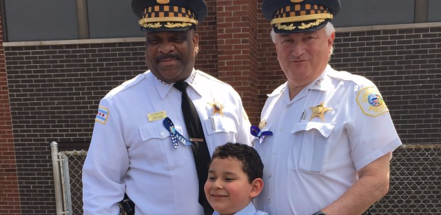 "Alejandro ""Alex"" Valadez Jr. poses with Chicago police superintendent Eddie Johnson (left). Alex received​ a new bike as a graduation gift from the Chicago Police Department."