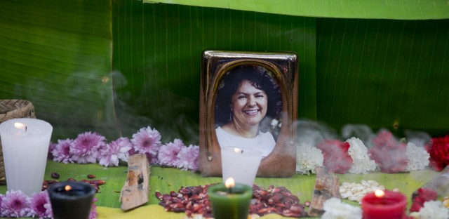 This June 15, 2016, file photo shows a framed image of environmentalist Berta Caceres on a makeshift altar made in her honor during a demonstration outside Honduras' embassy, in Mexico City. An international team of lawyers charged Tuesday, Oct. 31 2017, that the killing of Caceres was the product of a coordinated plot that began four months earlier and suggested that leadership of a dam development company may have ordered her assassination.
