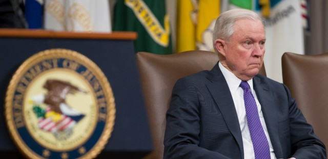 Attorney General Jeff Sessions is seated during an event to announce new strategic actions to combat the opioid crisis at the Department of Justice's National Opioid Summit in the Great Hall at the Department of Justice, Thursday, Oct. 25, 2018, in Washington.