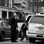 File: Chicago police officer arresting a juvenile.