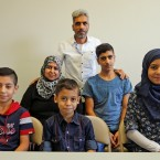 Nadim Fawzi Jouriyeh, rear, a Syrian refugee that arrived with his family in the United States this week, poses with the family in El Cajon, Calif. The family members are his wife Rajaa Abdo Altaleb, back left, son Mohammad Fawzi Jouriyeh, back right, daughter Hanan Nadim Jouriyeh, right, Farouq Nadim Jouriyeh, front center, and Hamzeh Nadim Jouriyeh, front left. San Diego's newest Syrian refugee arrivals include the Jouriyeh family of six from the city of Homs.