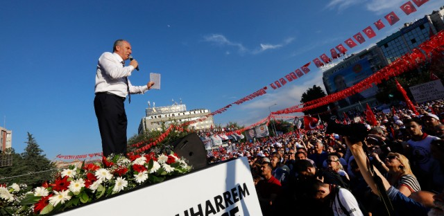 Muharrem Ince, presidential candidate of Turkey's main opposition Republican People's Party, talks to supporters during an election rally in Ankara, Turkey, Friday, June 22, 2018. Turkey holds parliamentary and presidential elections on June 24, 2018, deemed important as it will transform Turkey's governing system to an executive presidency.