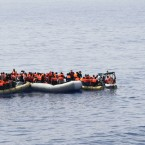 This undated image made available Monday, May 30, 2016 by the Italian Navy Marina Militare shows migrants being rescued at sea. Survivor accounts have pushed to more than 700 the number of migrants feared dead in Mediterranean Sea shipwrecks over three days in the past week, even as rescue ships saved thousands of others in daring operations.