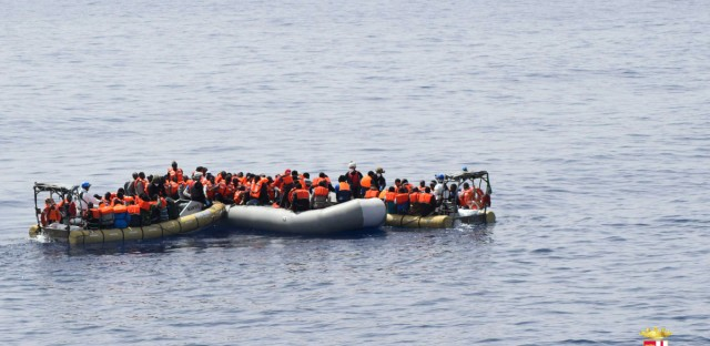 This undated image from the Italian Navy Marina Militare shows migrants being rescued at sea.