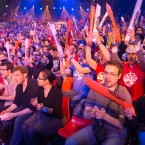 Fans watch the opening ceremony of the League of Legends season 4 World Championship Final between South Korea against China's Royal Club, in Paris, Sunday May 11, 2014.