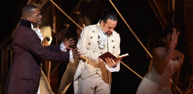 Actor Leslie Odom, Jr. (left) and actor, composer Lin-Manuel Miranda (right) perform on stage during the Hamilton Grammys performance.