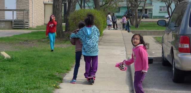 Children play in the streets and sidewalks of Marktown.