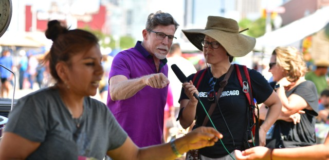 Rick Bayless and Monica Eng (right) visited the Maxwell Street Market.