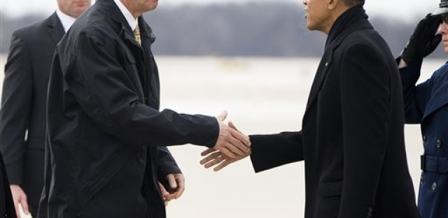 President Barack Obama is greeted by Illinois Gov. Bruce Rauner on the tarmac during his arrival on Air Force One at Abraham Lincoln Capitol Airport in Springfield, Ill., Wednesday, Feb. 10, 2016. Obama returned to Springfield, the place where his presidential career began, to mark the ninth anniversary of his entrance in the 2008 presidential race. He plans to deliver an address to the Illinois General Assembly at the Illinois State Capitol.
