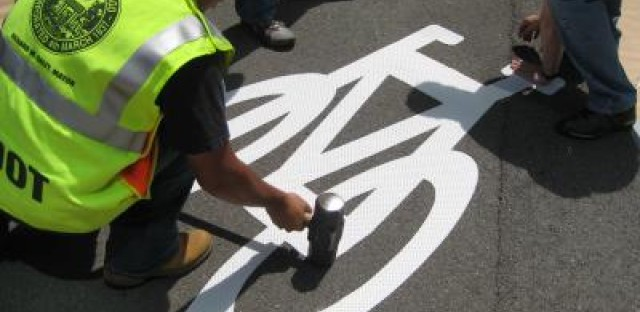 City workers put finishing touches on Kinzie lanes