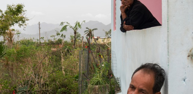 Jose Sanchez Acevedo, 52, and his mother, Cruz Acevedo Soler, 74, on the front porch of the Maricao farmhouse they live in. They told Mercy Corps they would purchase rice and beans if given $100.