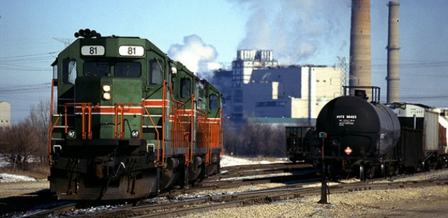Trains sit at the south end of the yard in Powerton, Ill., near the power plant. Powerton's coal plant was the second biggest greenhouse gas emitter in Illinois, according to EPA data.