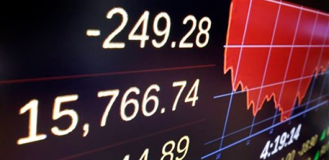 A screen above the trading floor of the New York Stock Exchange shows the closing number for the Dow Jones industrial average, Wednesday, Jan. 20, 2016. U.S. stocks recovered much of an early plunge, but the price of oil suffered its worst one-day drop since September.
