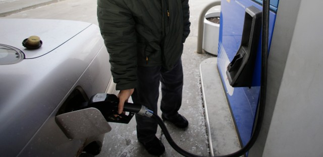 Samir Shabo fills up his tank at a Mobil gas station in Chicago, Thursday, Jan. 31, 2013. (AP Photo/Nam Y. Huh)