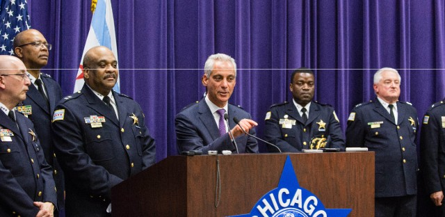 Eddie Johnson speaks to the media after Mayor Rahm Emanuel, right, announced that he was appointing him the interim superintendent of the Chicago Police Department at CPD Headquarters in Chicago on Monday, March 28, 2016. Johnson didn't apply for a chance to become Chicago's police chief, but the department's chief of patrol could address many challenges facing Emanuel and a city reeling from a police shooting scandal.